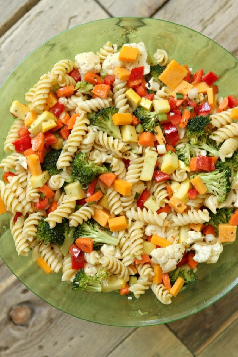 summer veggie pasta salad in green bowl