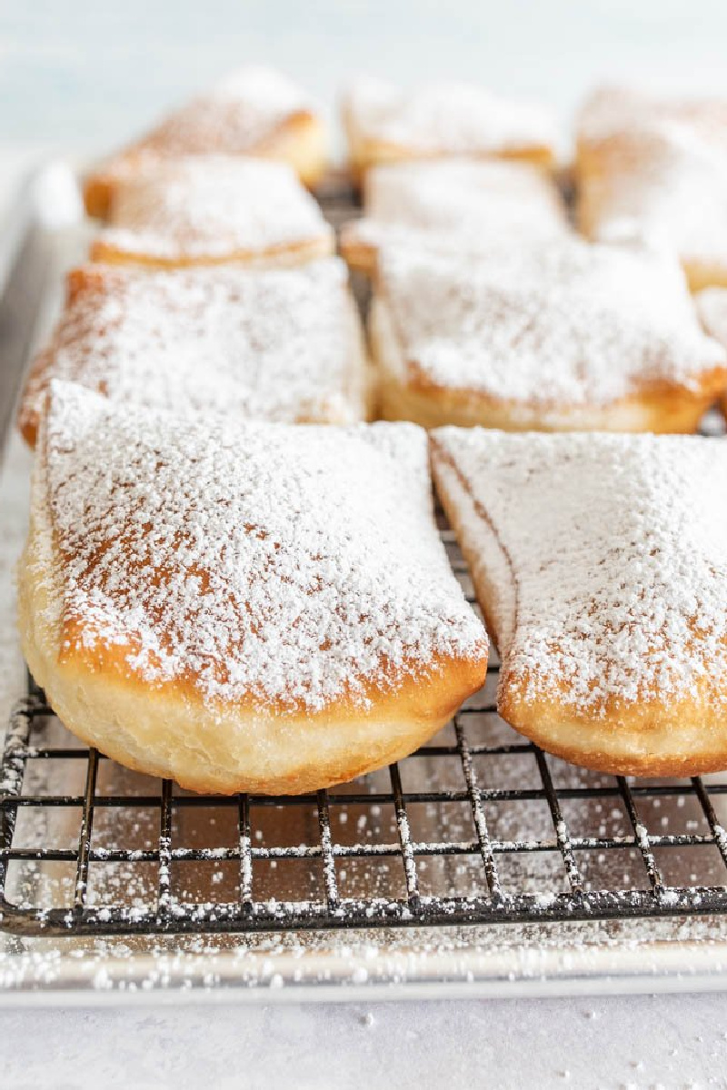 beignets on a cooling rack