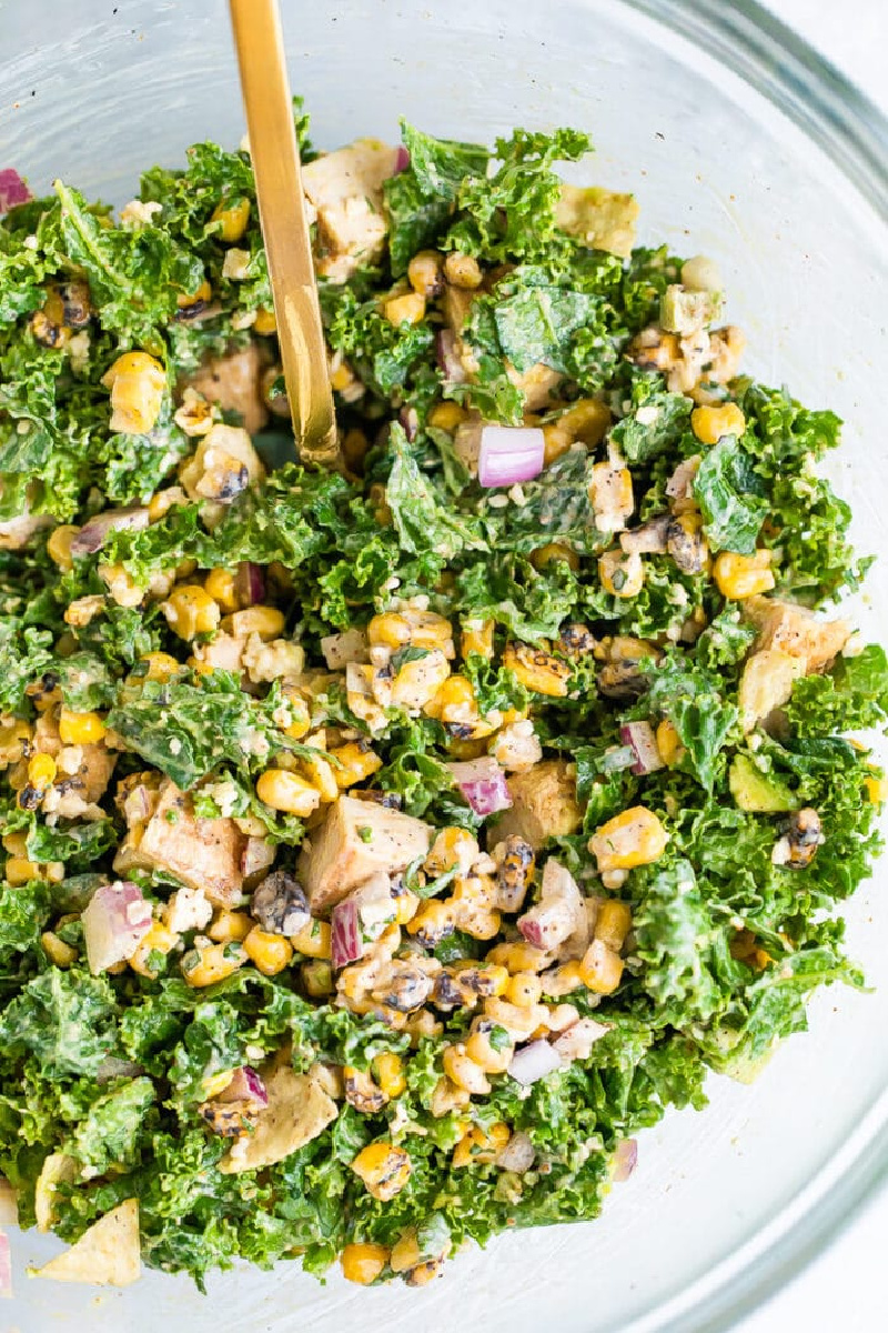 kale mexican street corn salad in white bowl