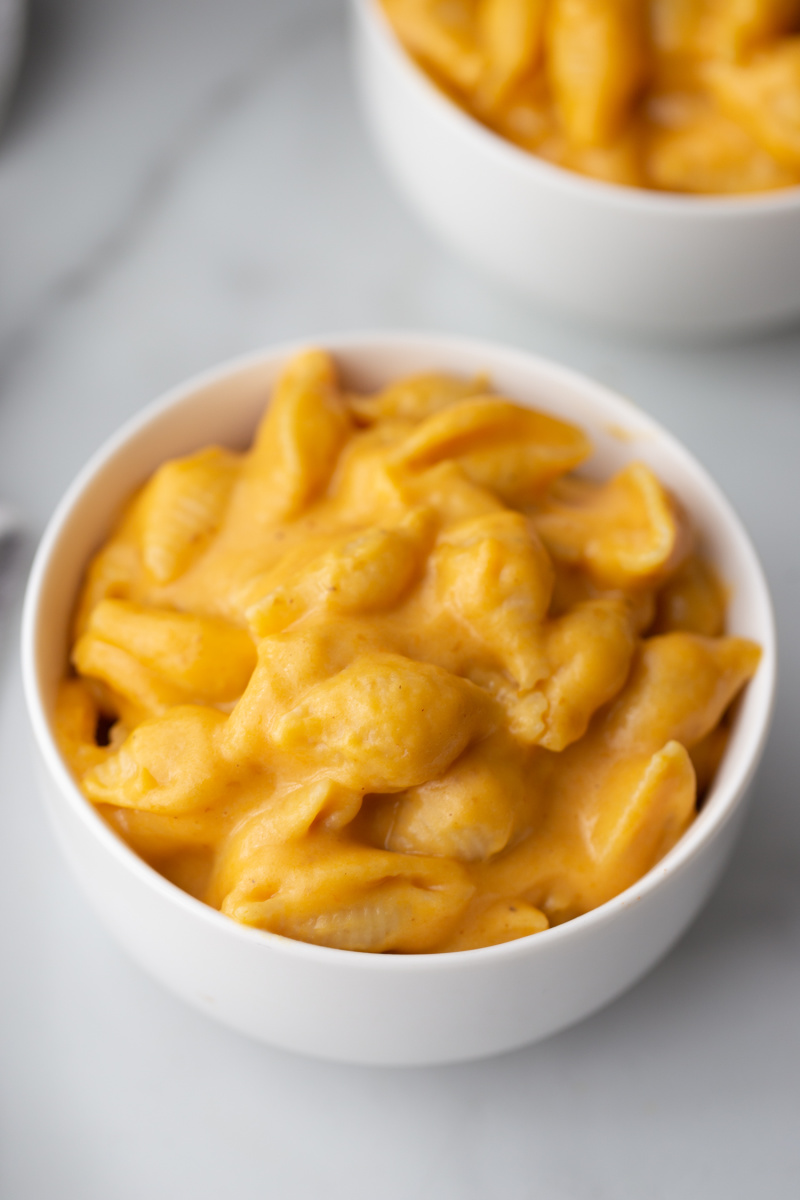 macaroni and cheese in a white bowl