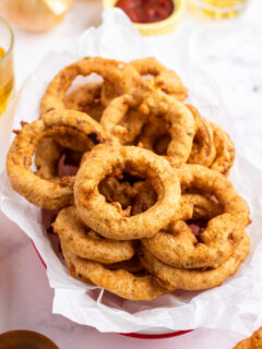 beer battered onion rings in a basket