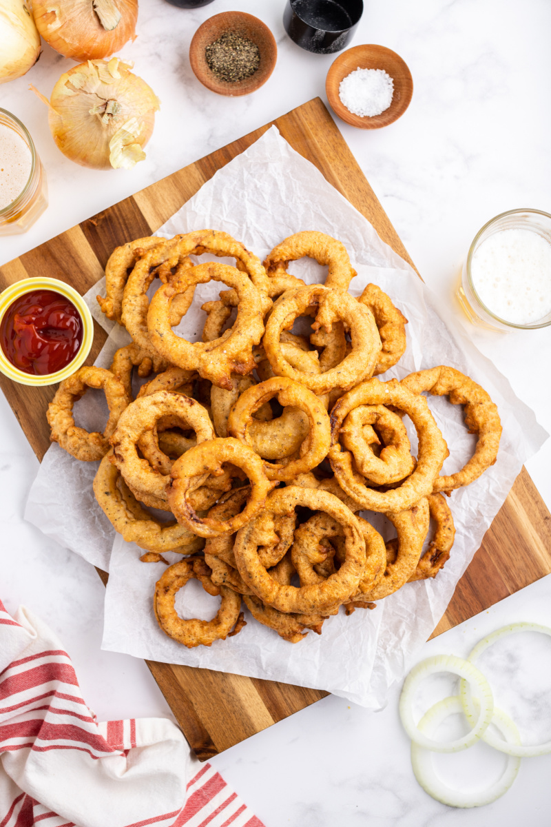 onion rings displayed with a container of ketchup