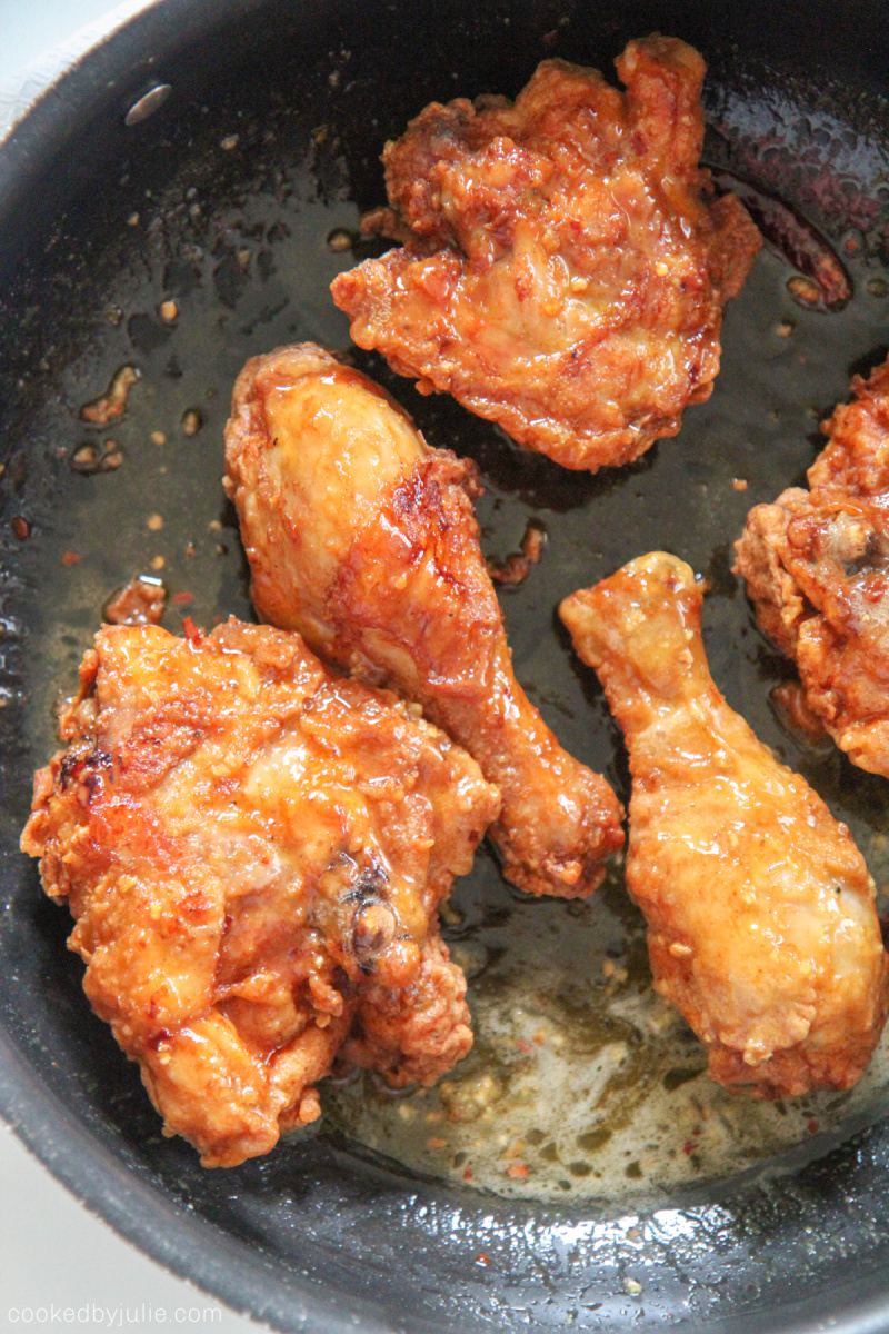 honey butter fried chicken in the pan