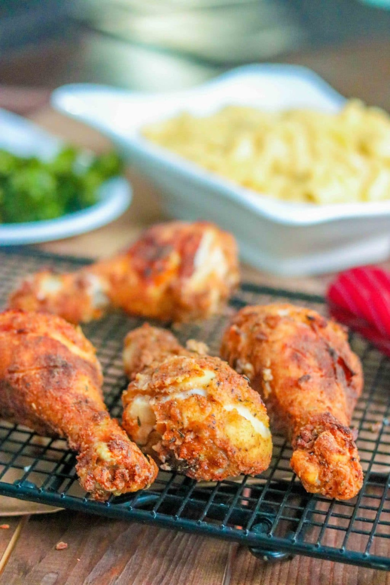 oven fried chicken on a cooling rack