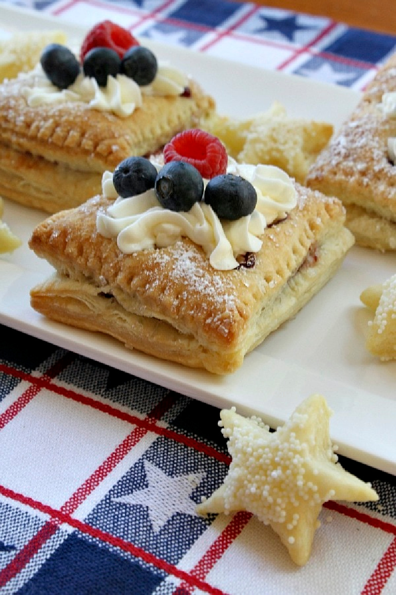 red white and blue pastries with berries and cream