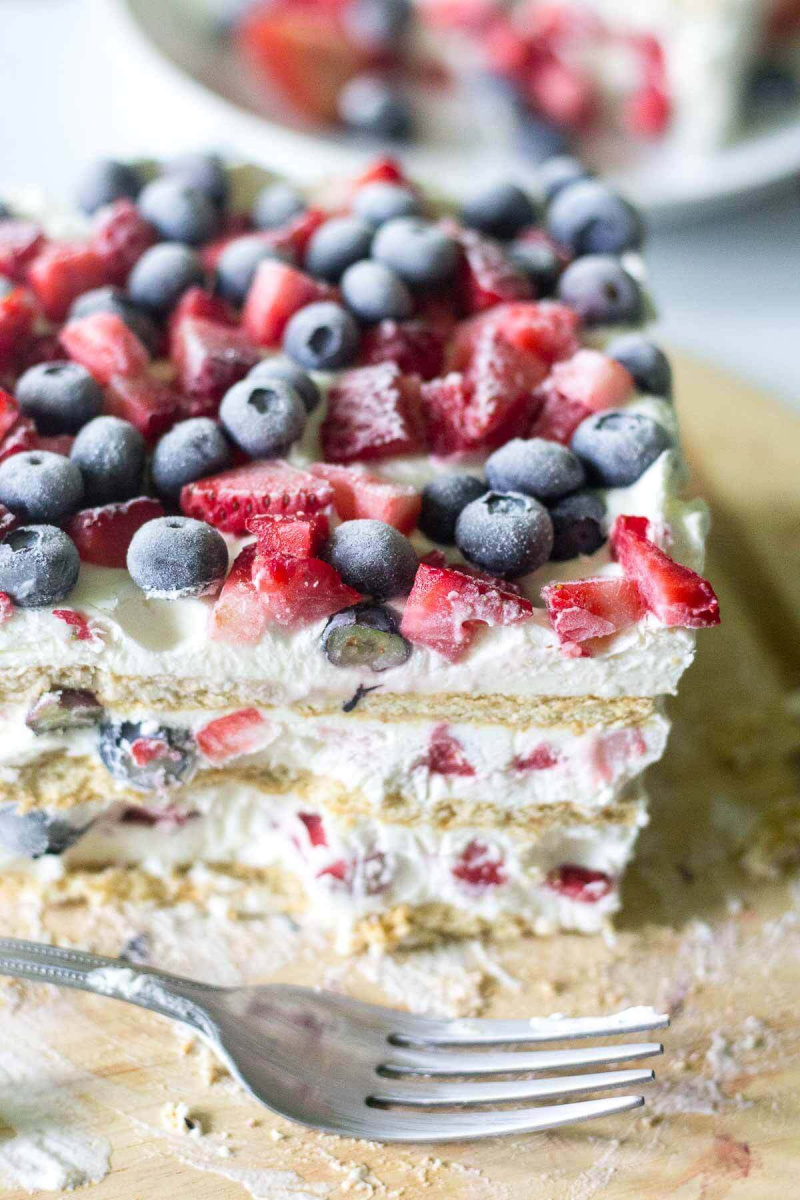 red white and blue icebox cake slice with fork