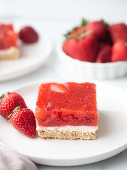 slice of strawberry pretzel salad on white plate