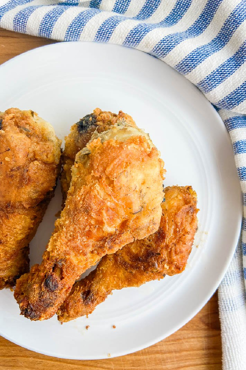 summer savory brined fried chicken on a white plate