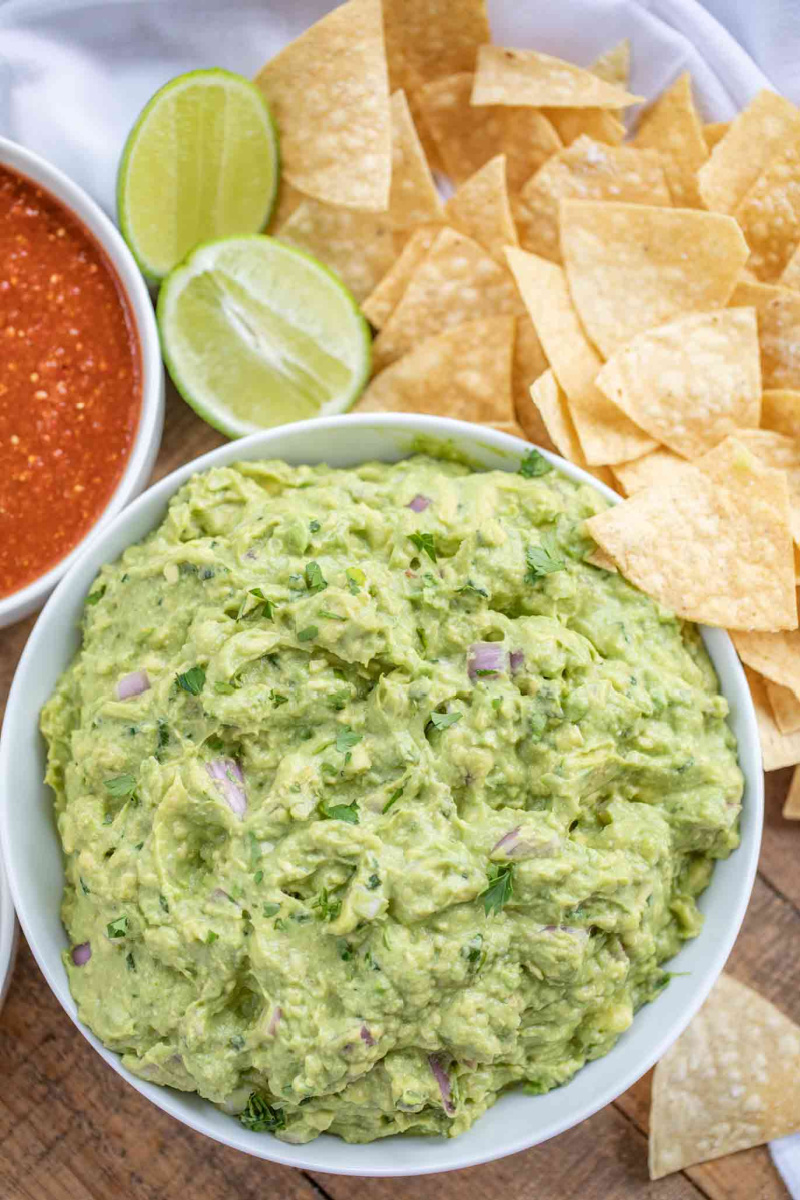 chipotle guacamole in white bowl with chips
