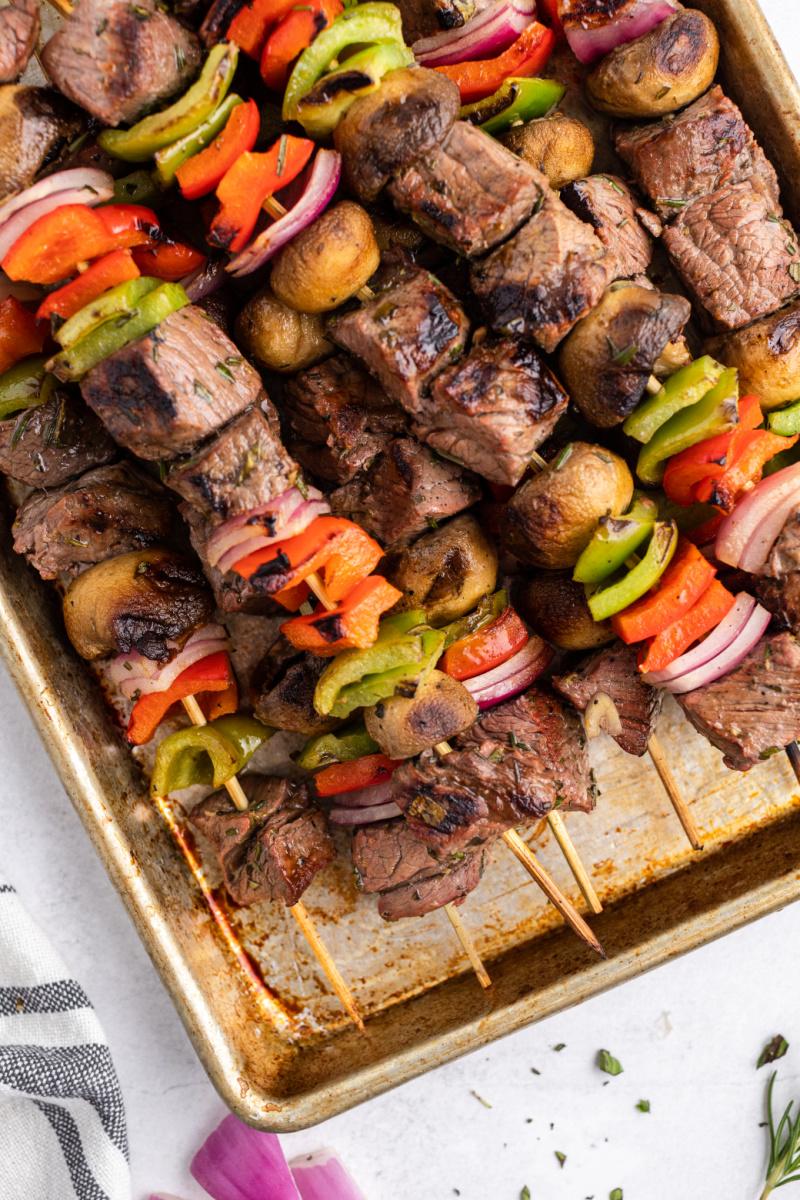 grilled lemon garlic steak kebabs on a baking sheet