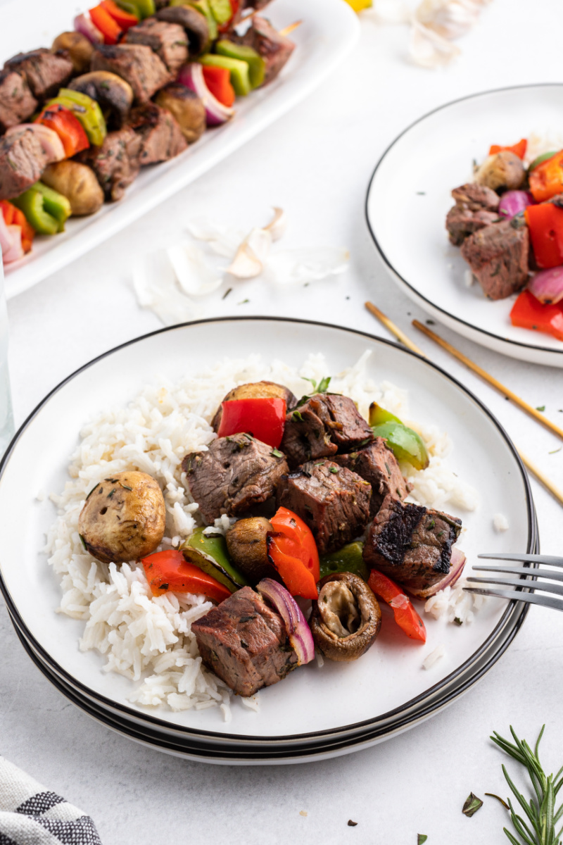 steak and vegetables served with rice on a plate