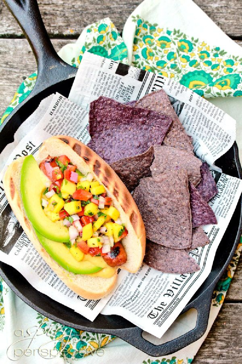 hawaiian hot dog in a paper lined basket with chips