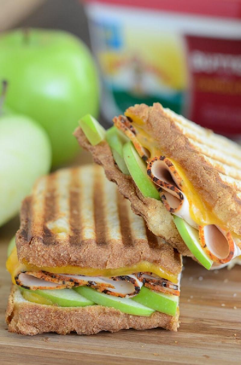 two slices apple cheddar turkey panini