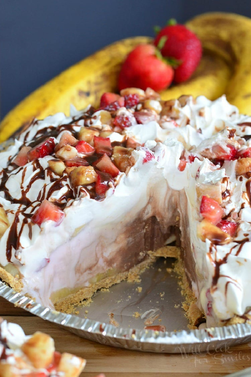 banana split ice cream pie with a slice taken out of it