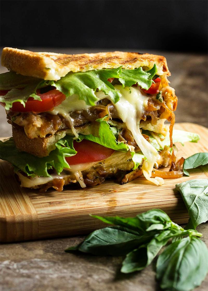 italian chicken pesto panini on cutting board