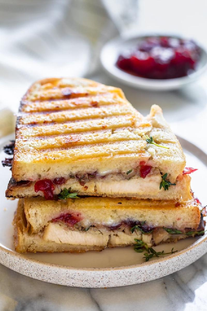 leftover thanksgiving turkey panini on white plate