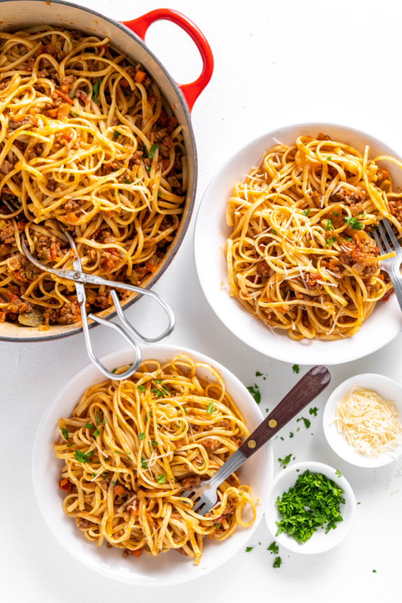 pot of linguine with bolognese with two servings