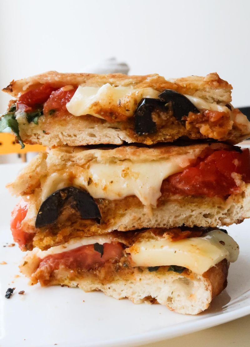 stacked slices of pesto and mozzarella panini