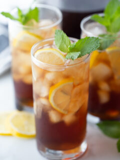 tall glass of southern sweet tea garnished with mint